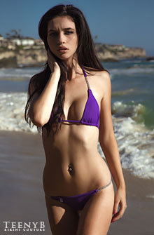 Deena Kacie in a purple bikini