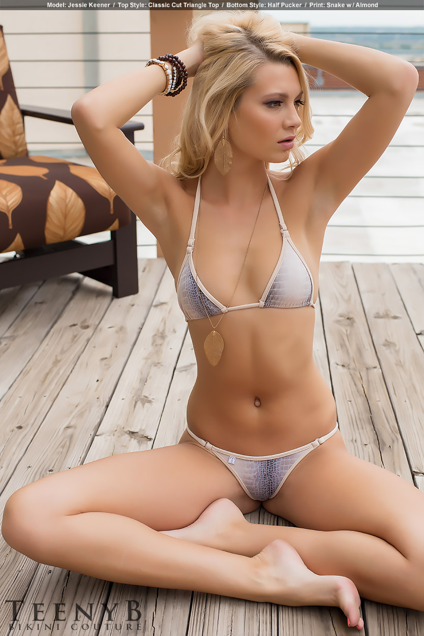 Jessie Keener in a floral print bikini by TeenyB Charlize Theron